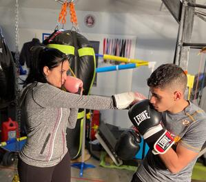 Practicing boxing with boy